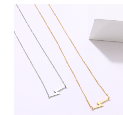 silver and gold lightning bolt necklace
