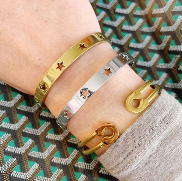 this is an image with our gold safety pin cuff bracelet being worn