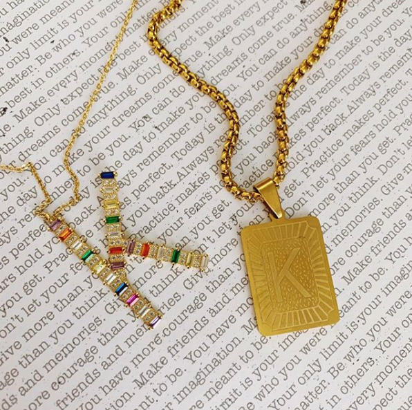 This is an image of our rainbow cz K necklace and our gold K rectangle medallion necklace