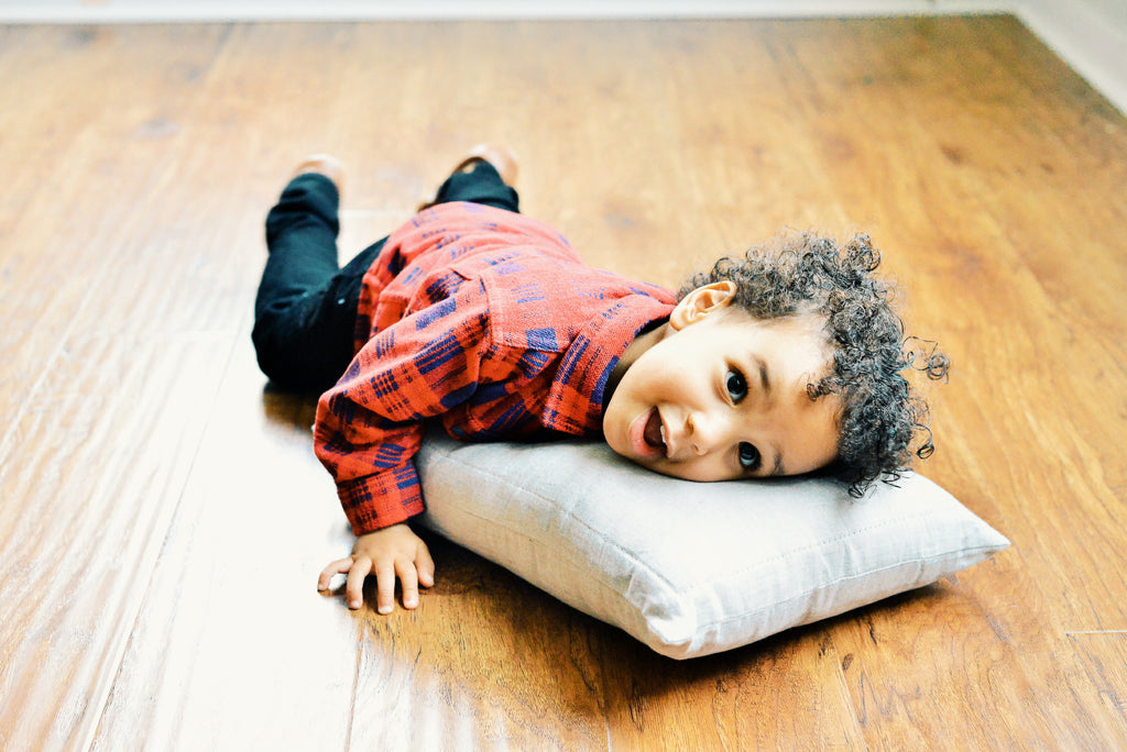 2 year old toddler Kingsley getting his first toddler pillow by Wholesome Linen