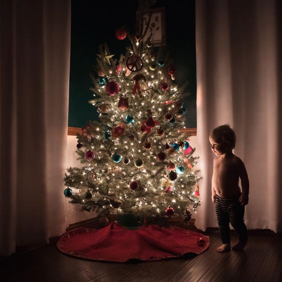 Photo of toddler by Christmas Tree by Meg Loeks