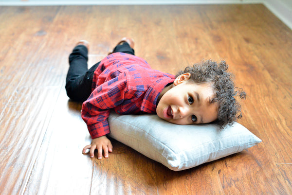 Toddler Kingsley on his First Tiny Pillow by Wholesome Linen