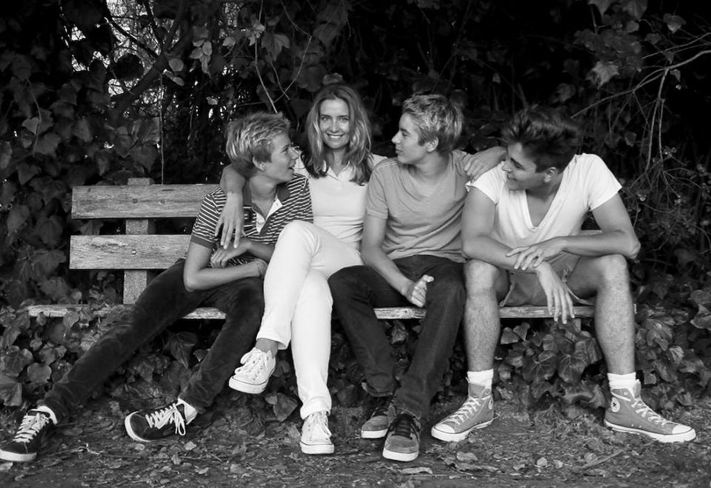 Happy Mother with her Three Teenage Boys | Black and White Portrait by Yuliia Barbashova