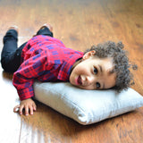 Kingsley meeting his first Organic Toddler Pillow by Wholesome Linen