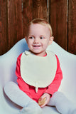 Baby wearing Wholesome Linen's Organic Baby Bib