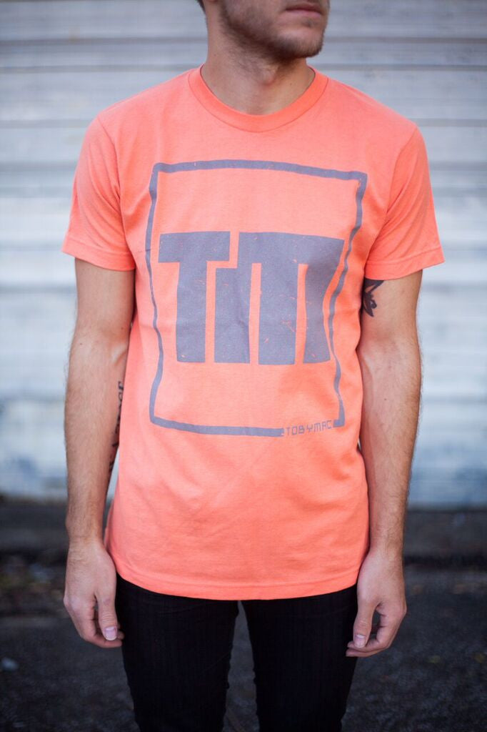 TM Gray Logo on Coral Tee