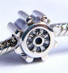 Sterling silver ship wheel charm for European charm bead style bracelets... click for more information