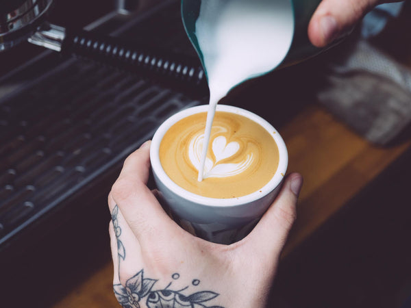 Flat white coffee pouring milk