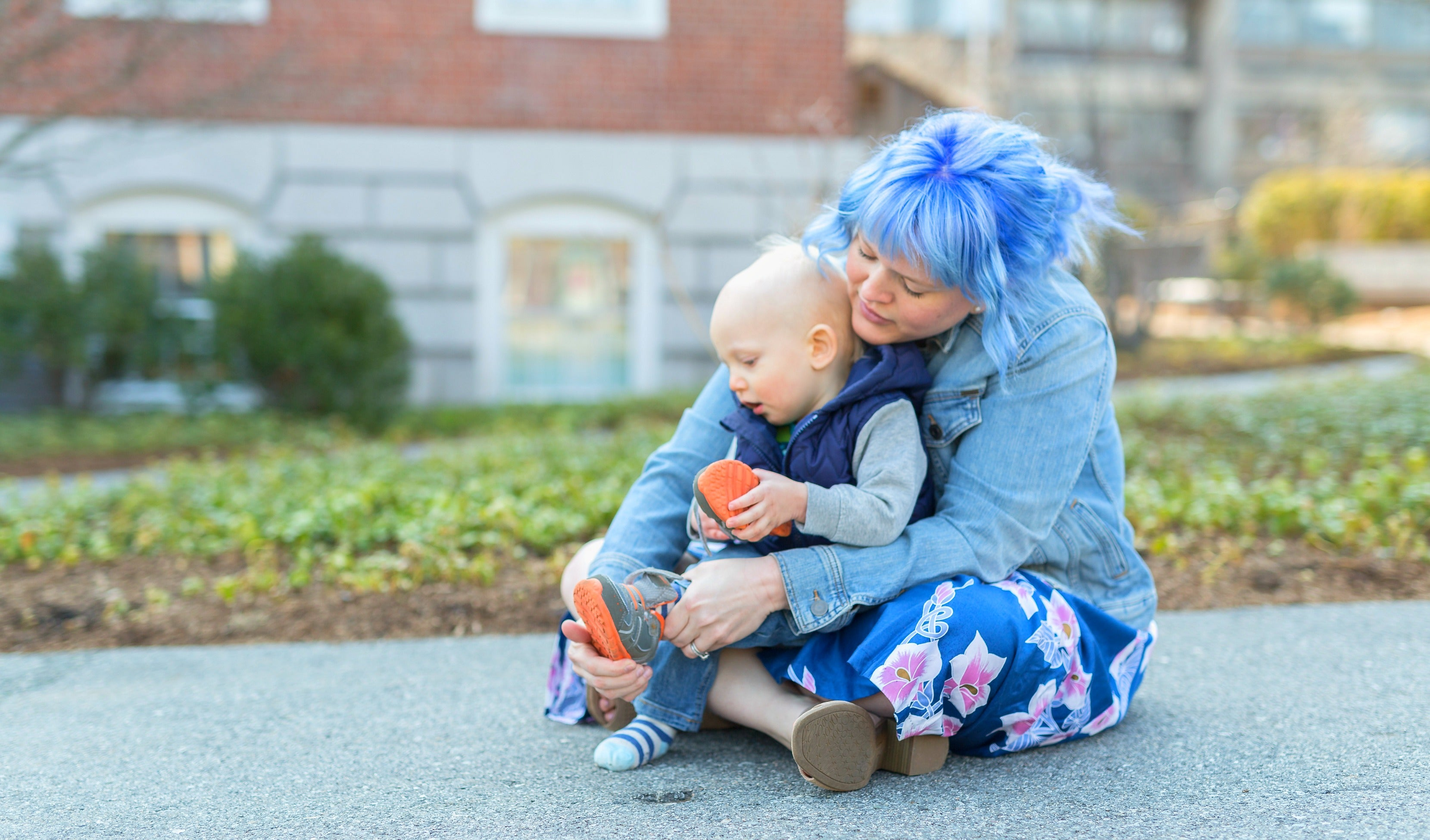Mommy with blue hair, son in lap