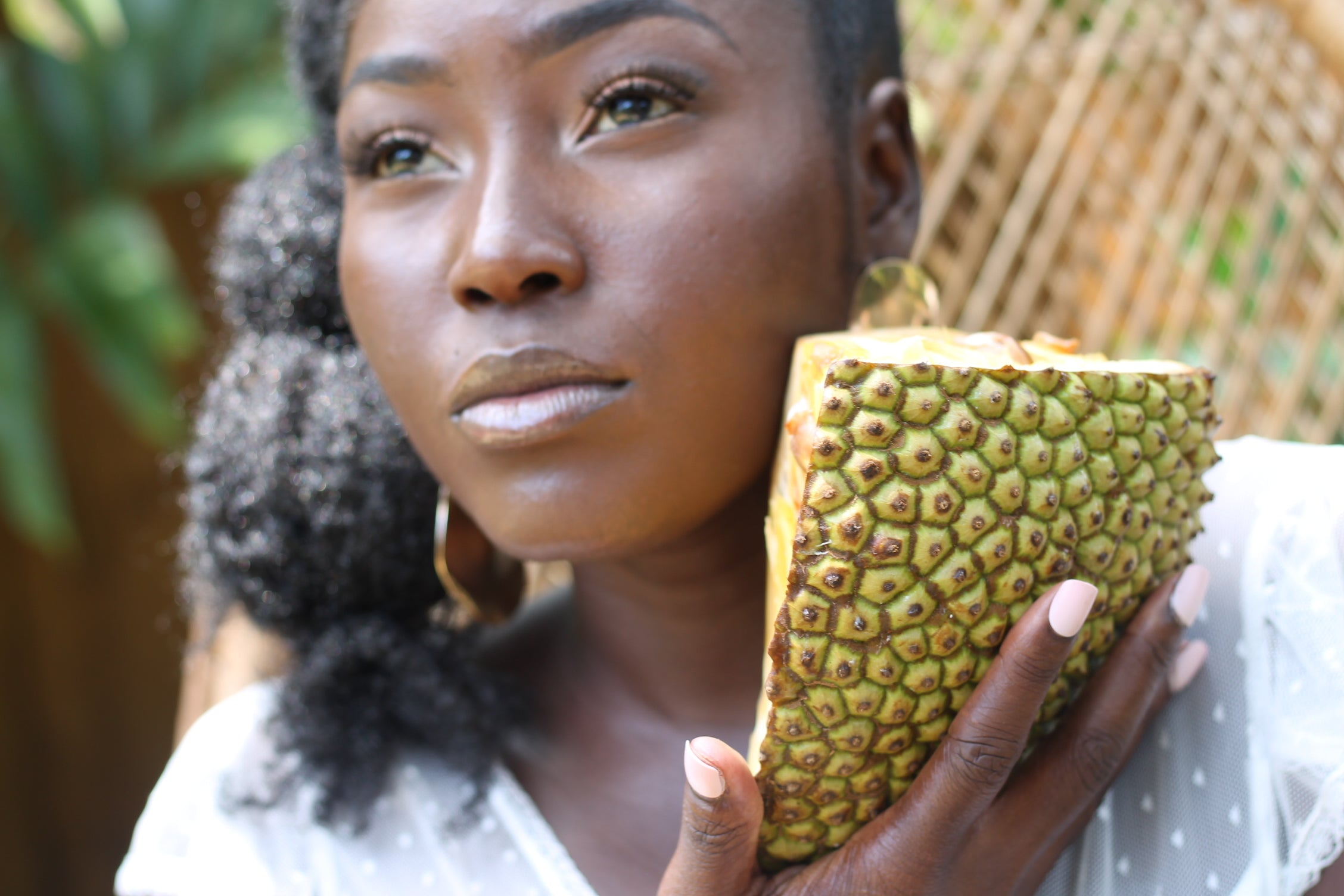 black woman holding papaya fruit