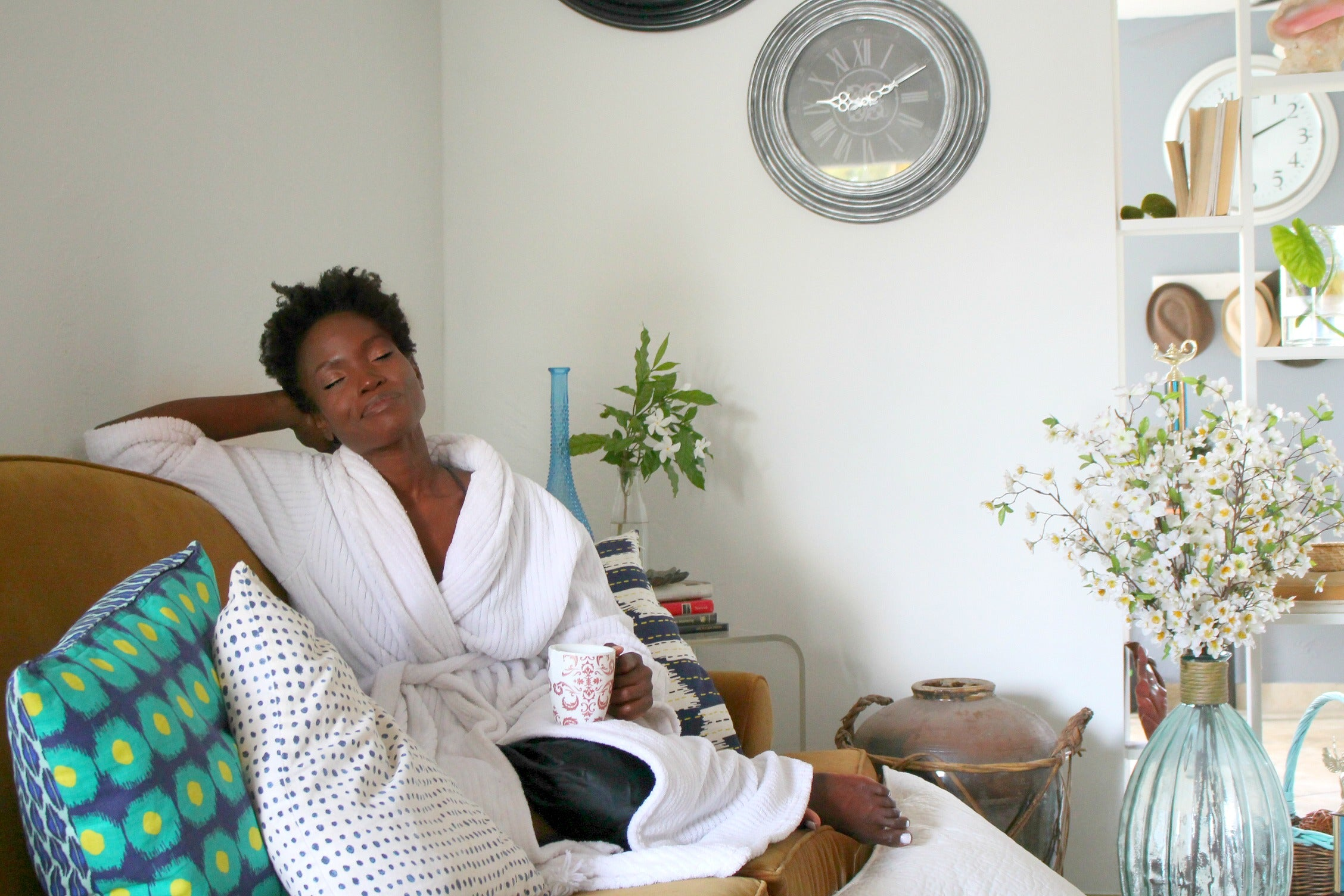 black woman relaxing in robe