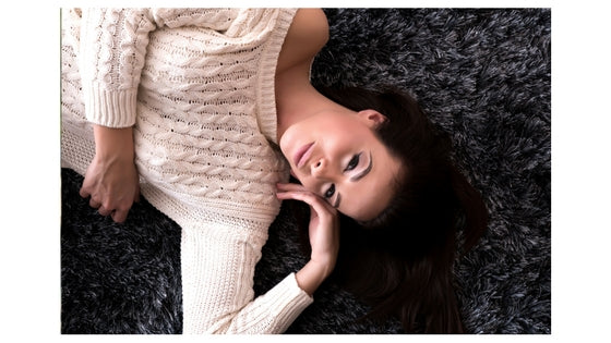 brunette woman lying down, smiling