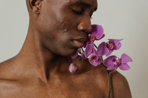 Black man, purple flowers