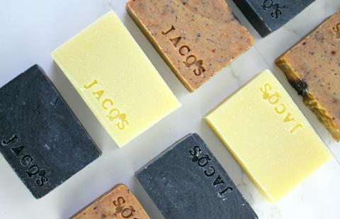 JACQ's flatlay of natural soap bars, multiple colors