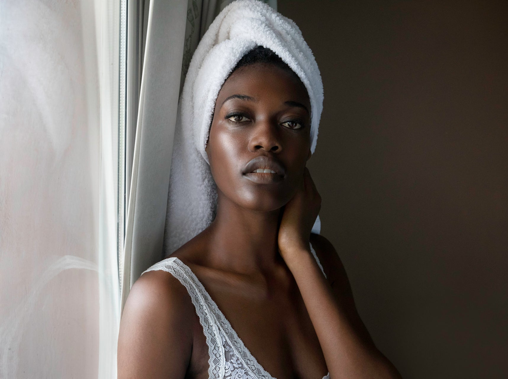 BLACK WOMAN WITH TOWL ON HEAD, CLEAR SKIN