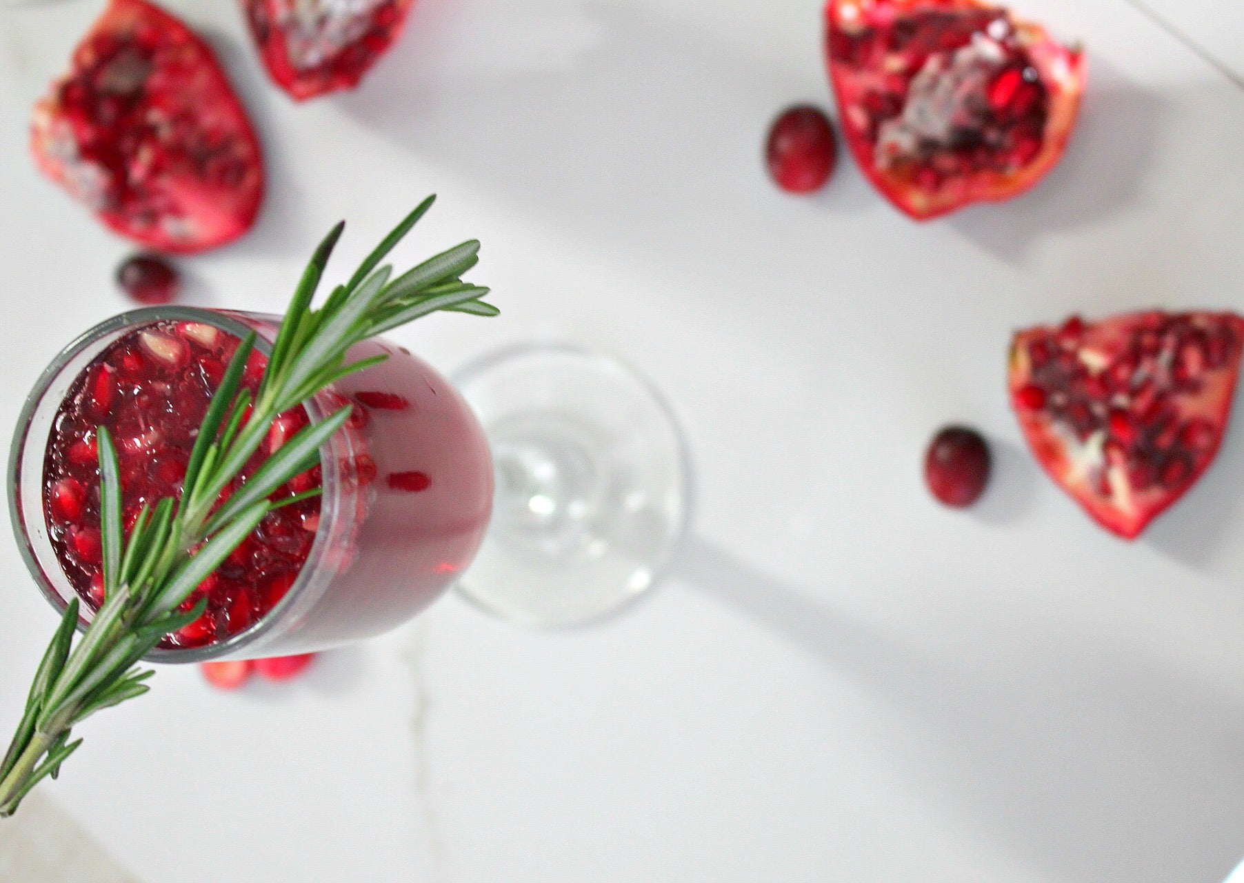 pomegranate & cranberry mimosa, with sliced pomegranate