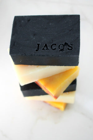 stack of JACQ's organic beauty bars