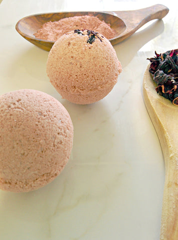 2 JACQ's organic hibiscus bath bombs, 2 wooden spoons