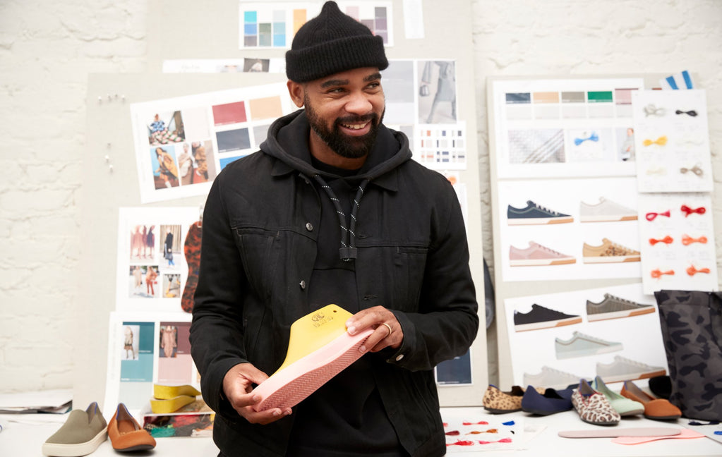 Product designer Lavion, shown holding up a shoe prototype.