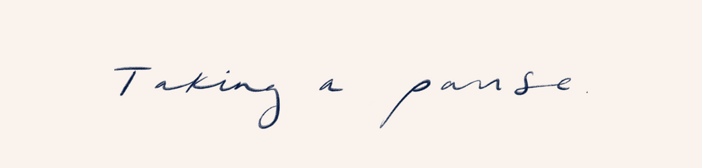 "Image of the handwritten phrase ""Taking a pause"""