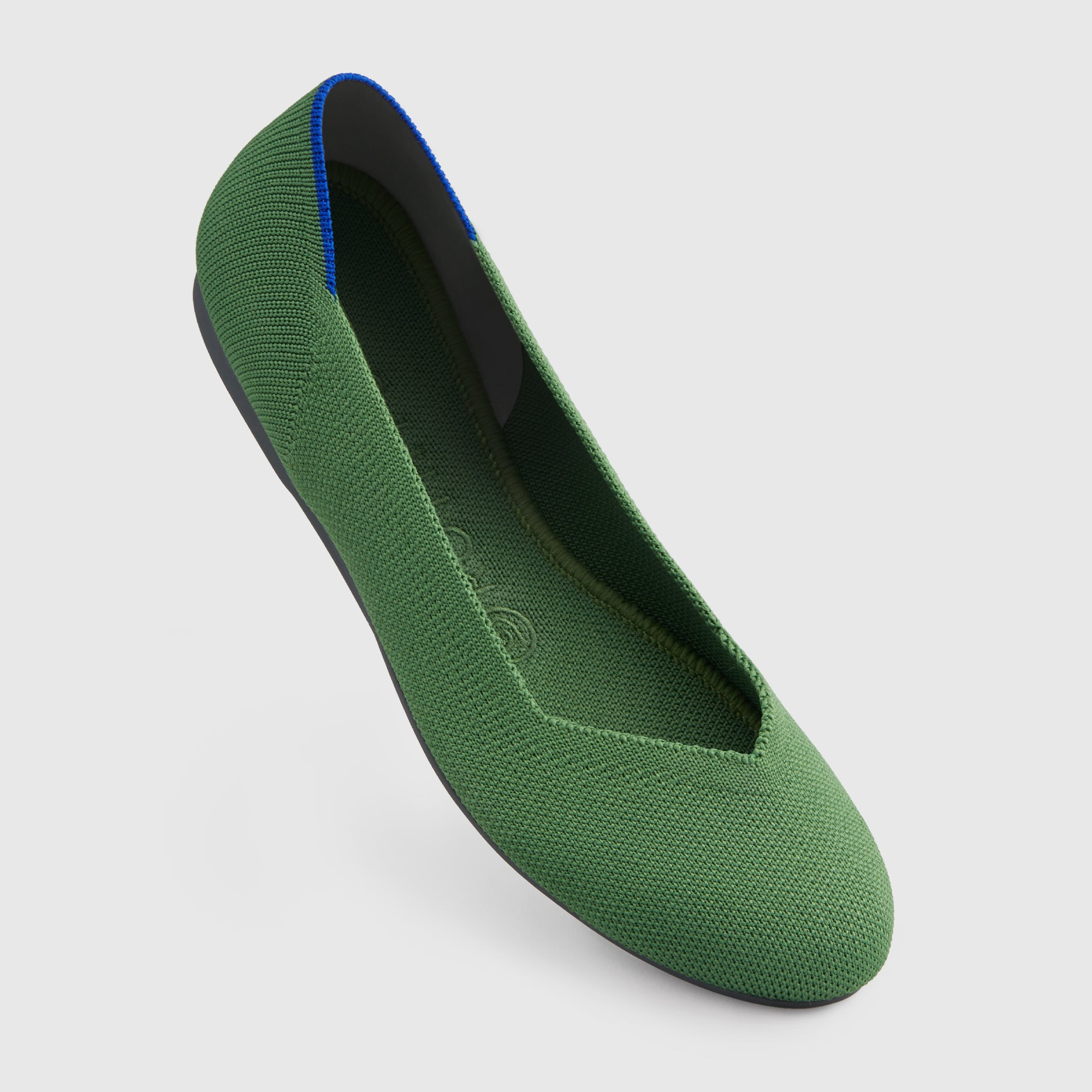 The Flat round toe shoe in Willow shown from the front at an angle.