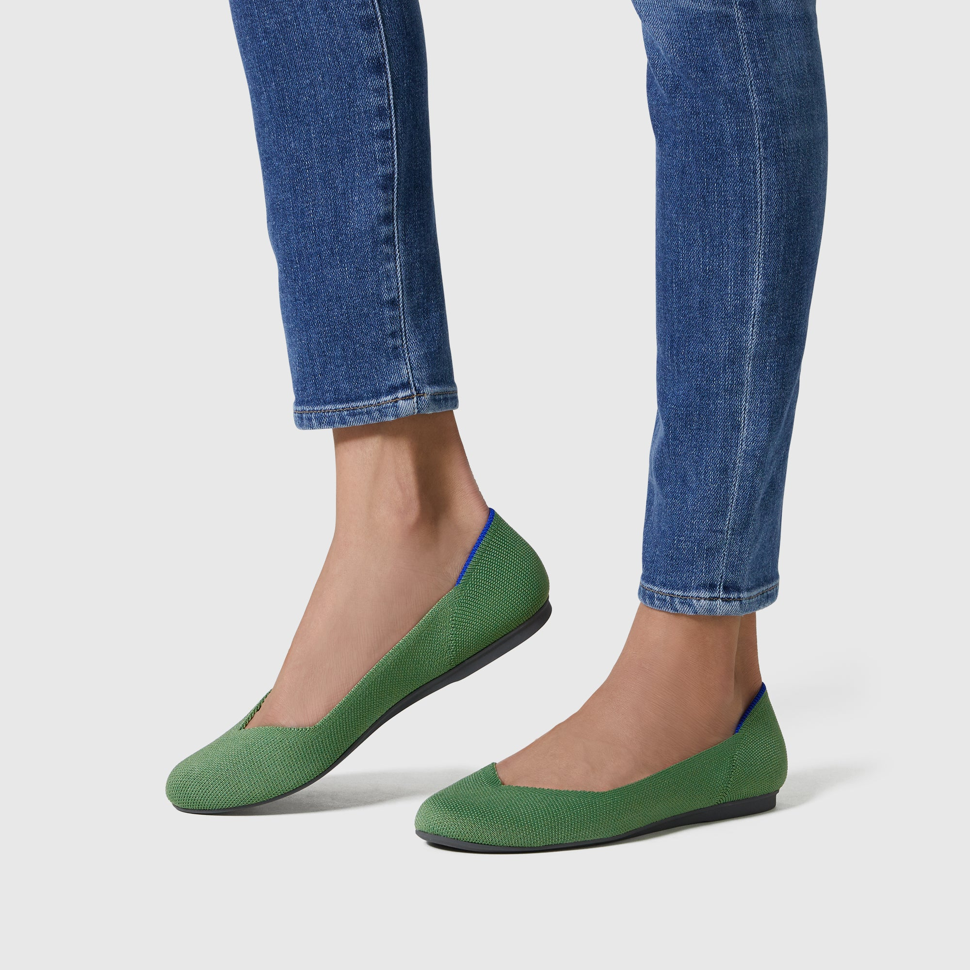 The Flat round toe shoe in Willow shown on-model at an angle.