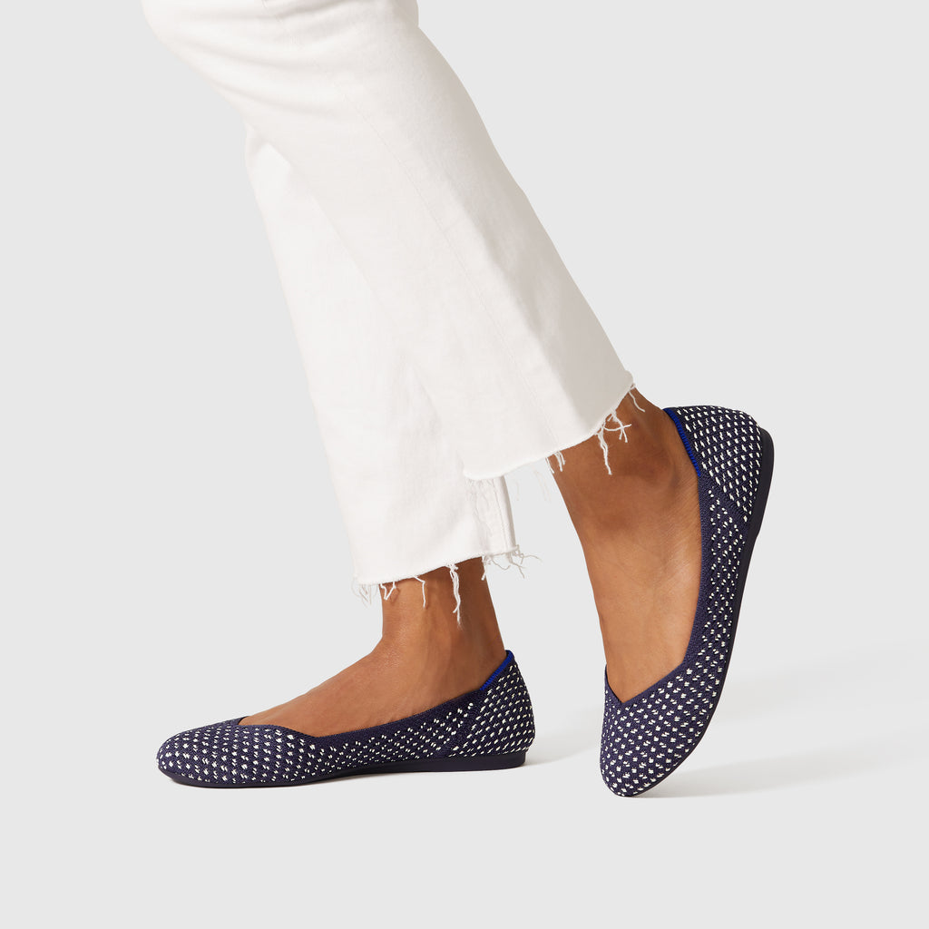 The Flat round toe shoe in Maritime Honeycomb shown on-model at an angle.