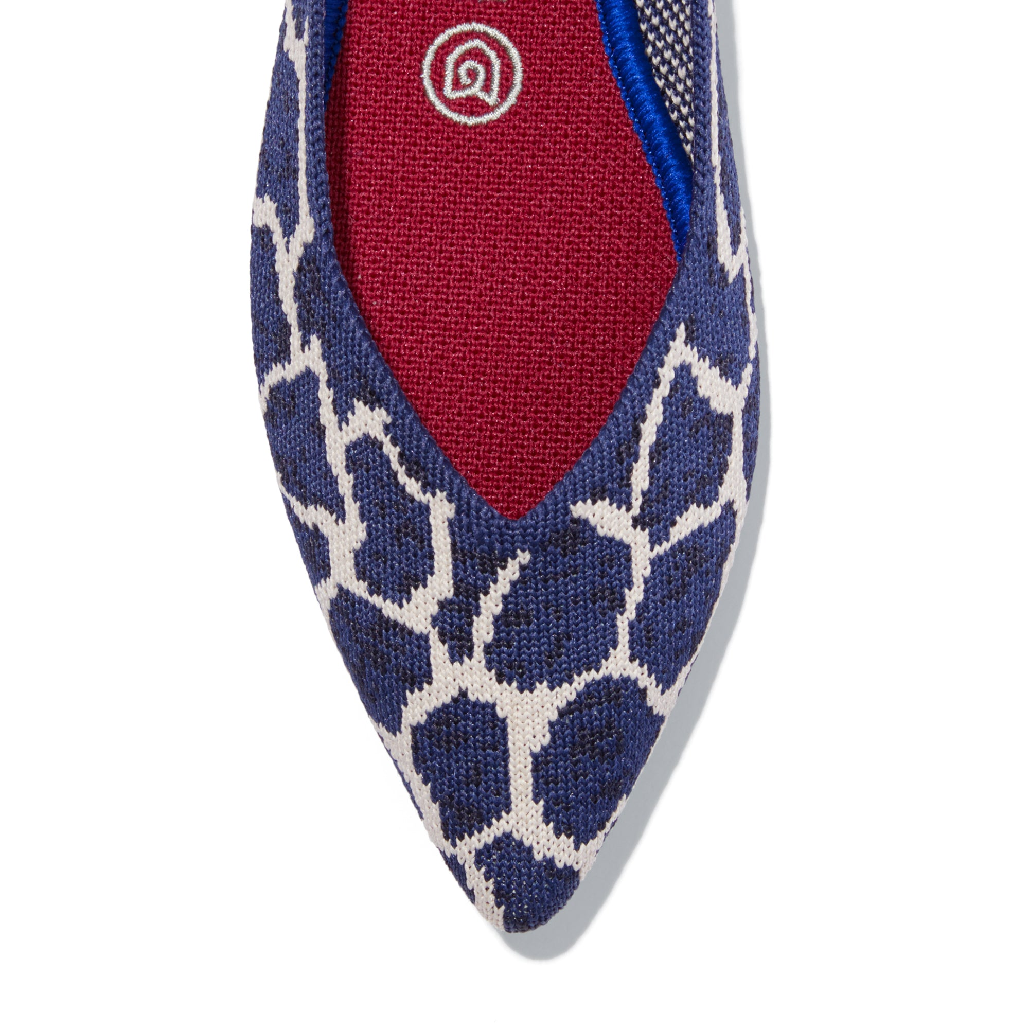 The Point shoe in Indigo Giraffe shown from the top view with detailing of the front of the shoe.