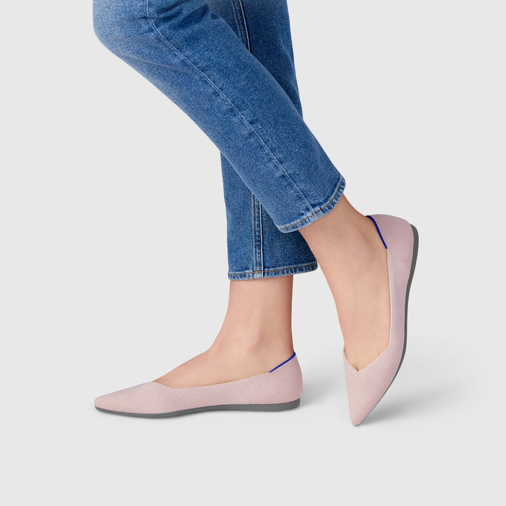 The Point shoe in Petal Pink Solid shown on-model at an angle.