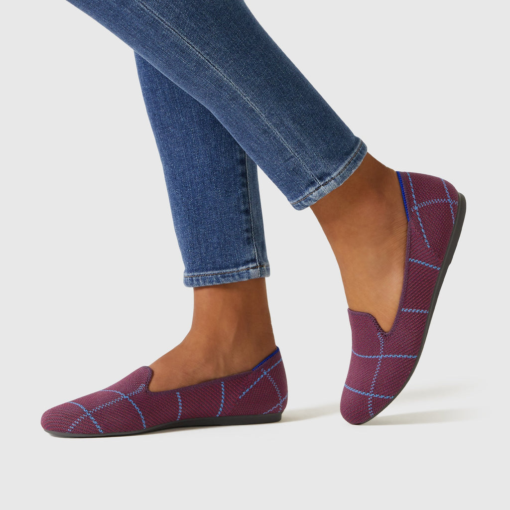 The Loafer in Burgundy Grid shown on-model at an angle.