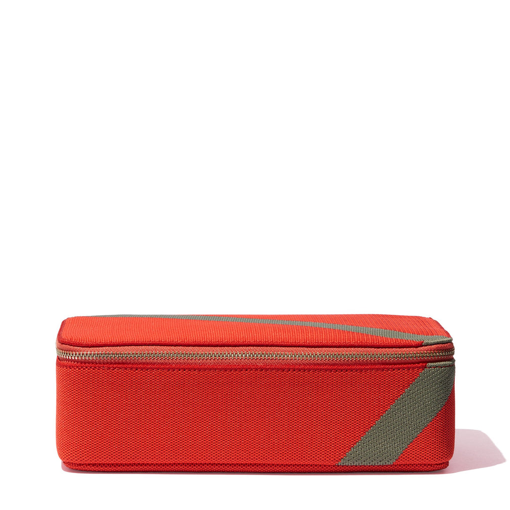The Large Catchall in Bright Poppy shown from the side.