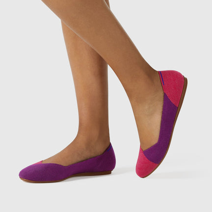 The Square Toe Flat in Cherry Violet shown on-model at an angle.