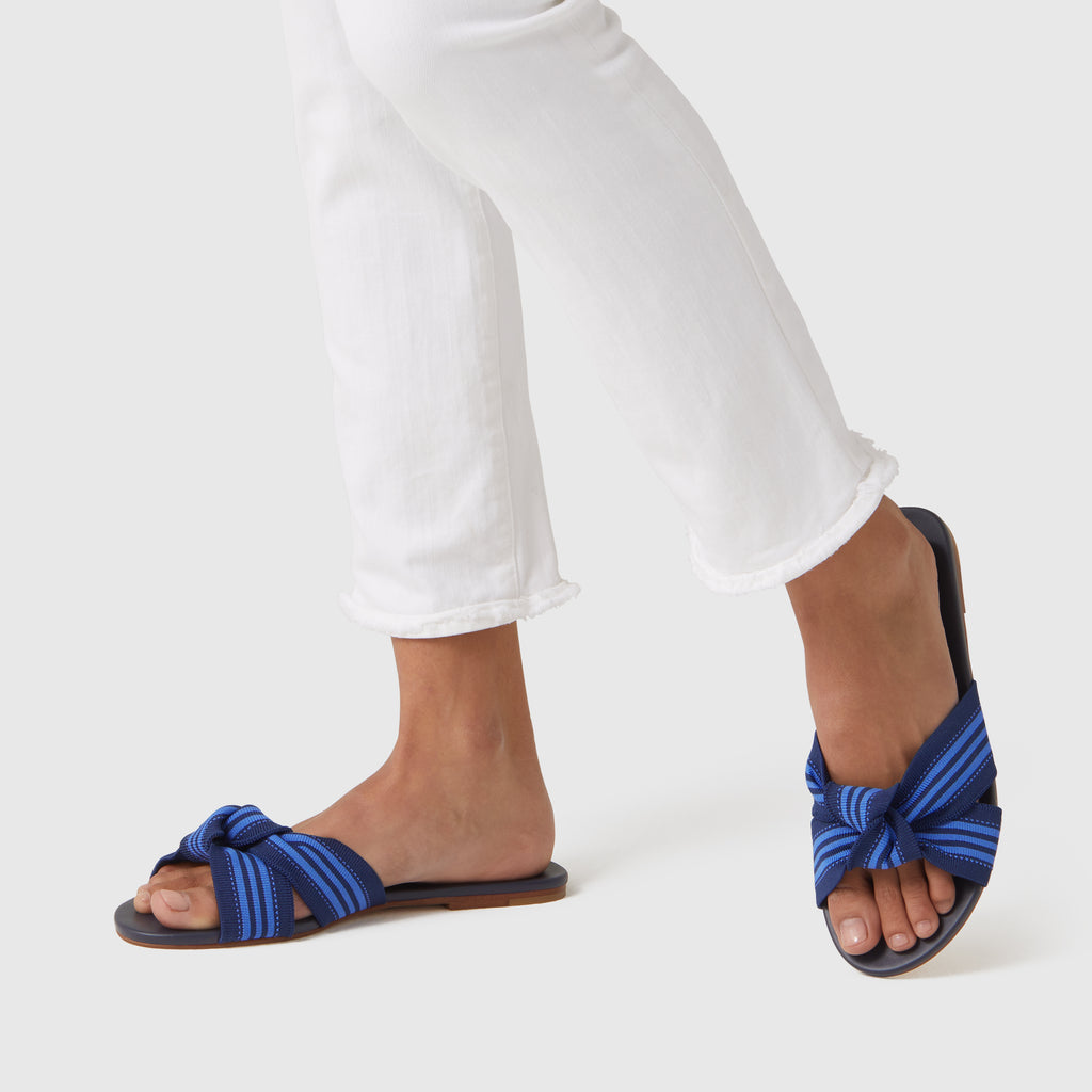 The Knot sandal  in Cobalt Stripe shown on-model at an angle.