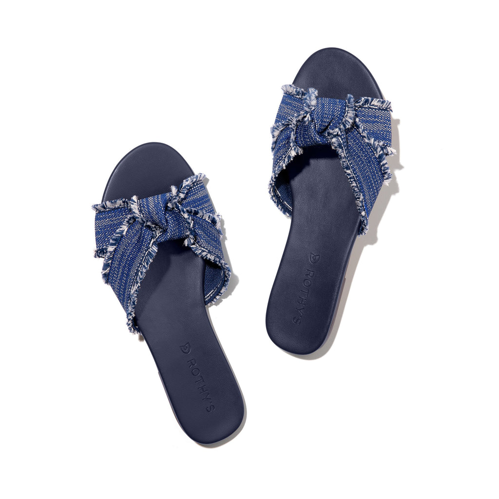 A pair of The Knot sandals in Indigo Fringe shown from the top view.