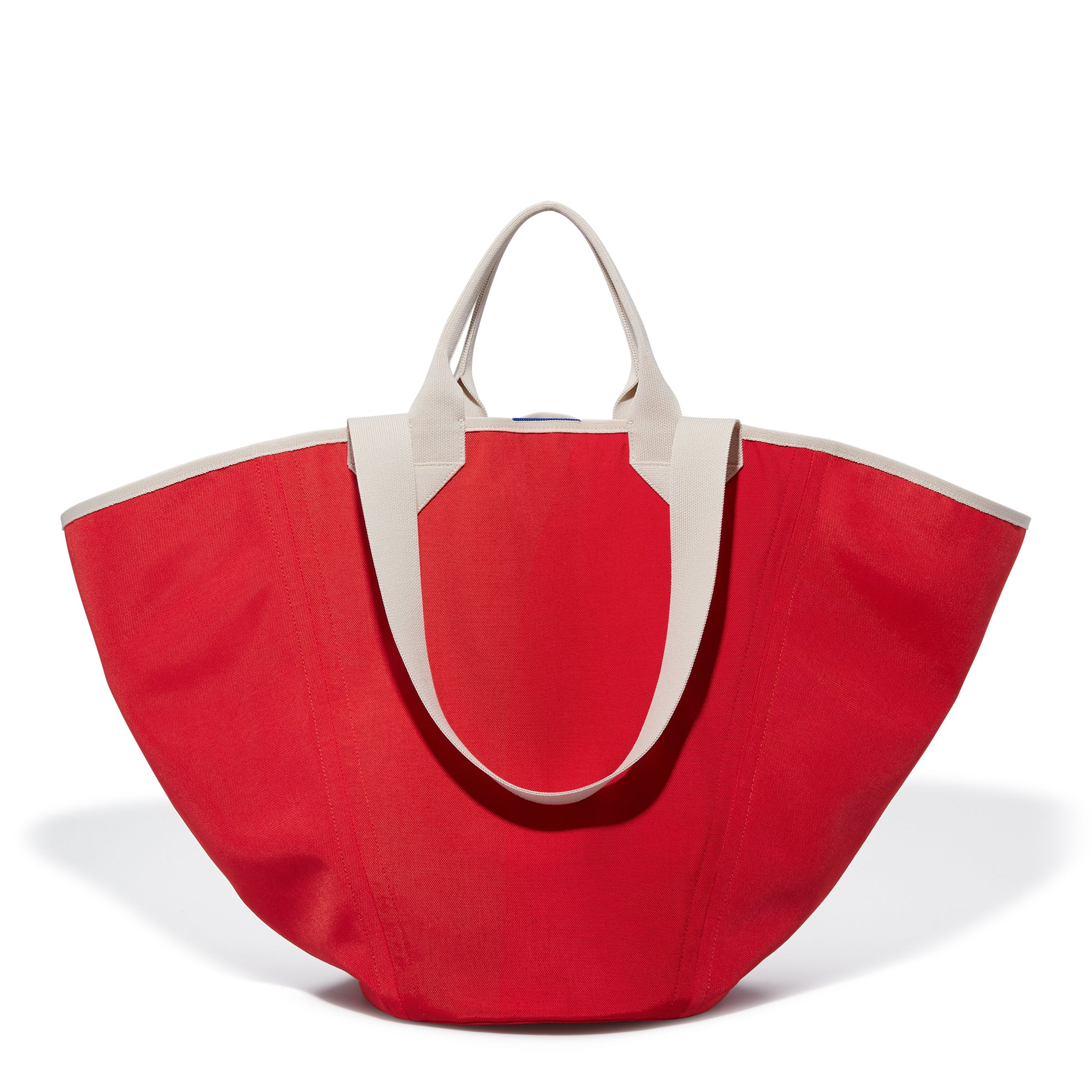 The Reversible Tote in Red & Cobalt shown from the front.