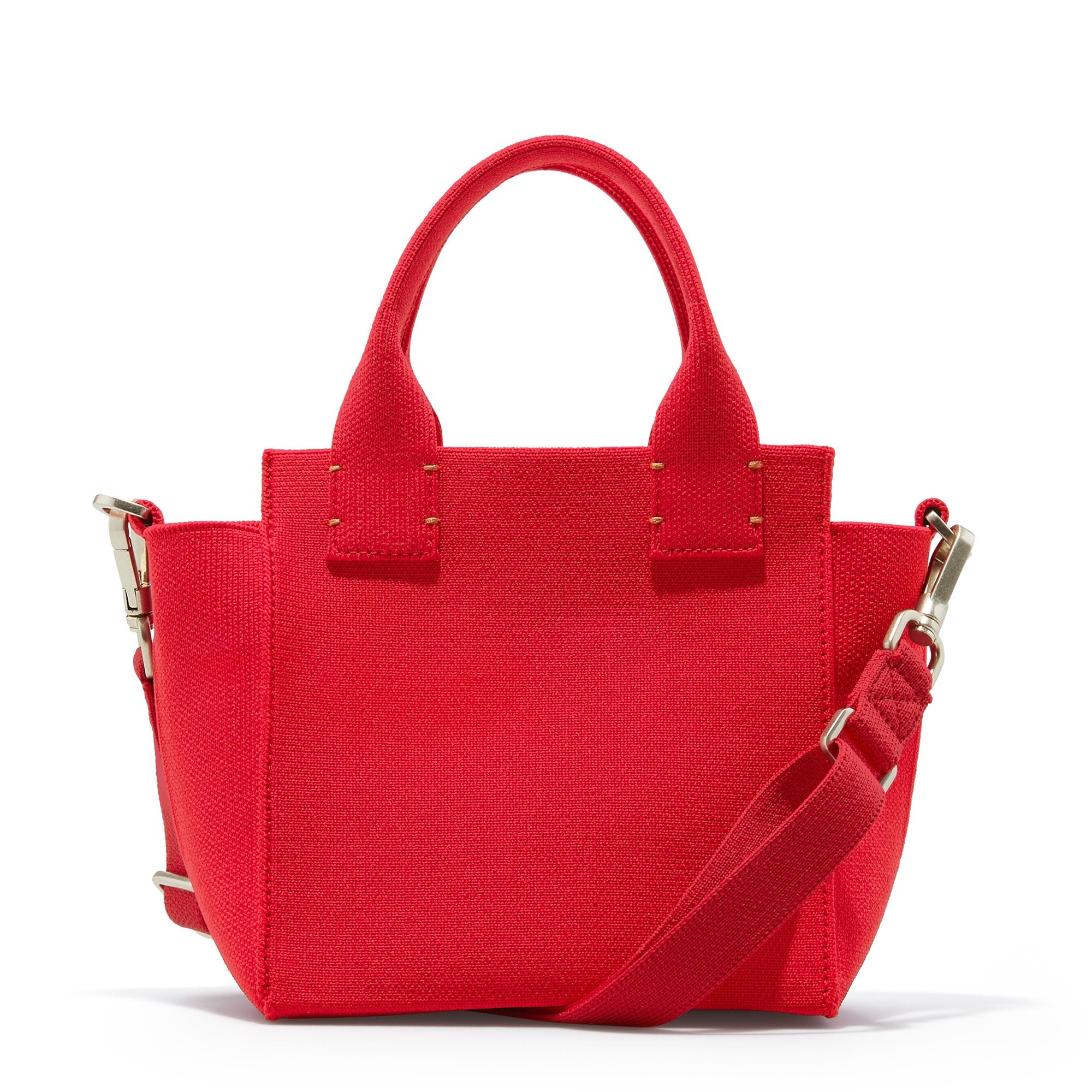 The Mini Handbag in Candy Apple shown from the back.