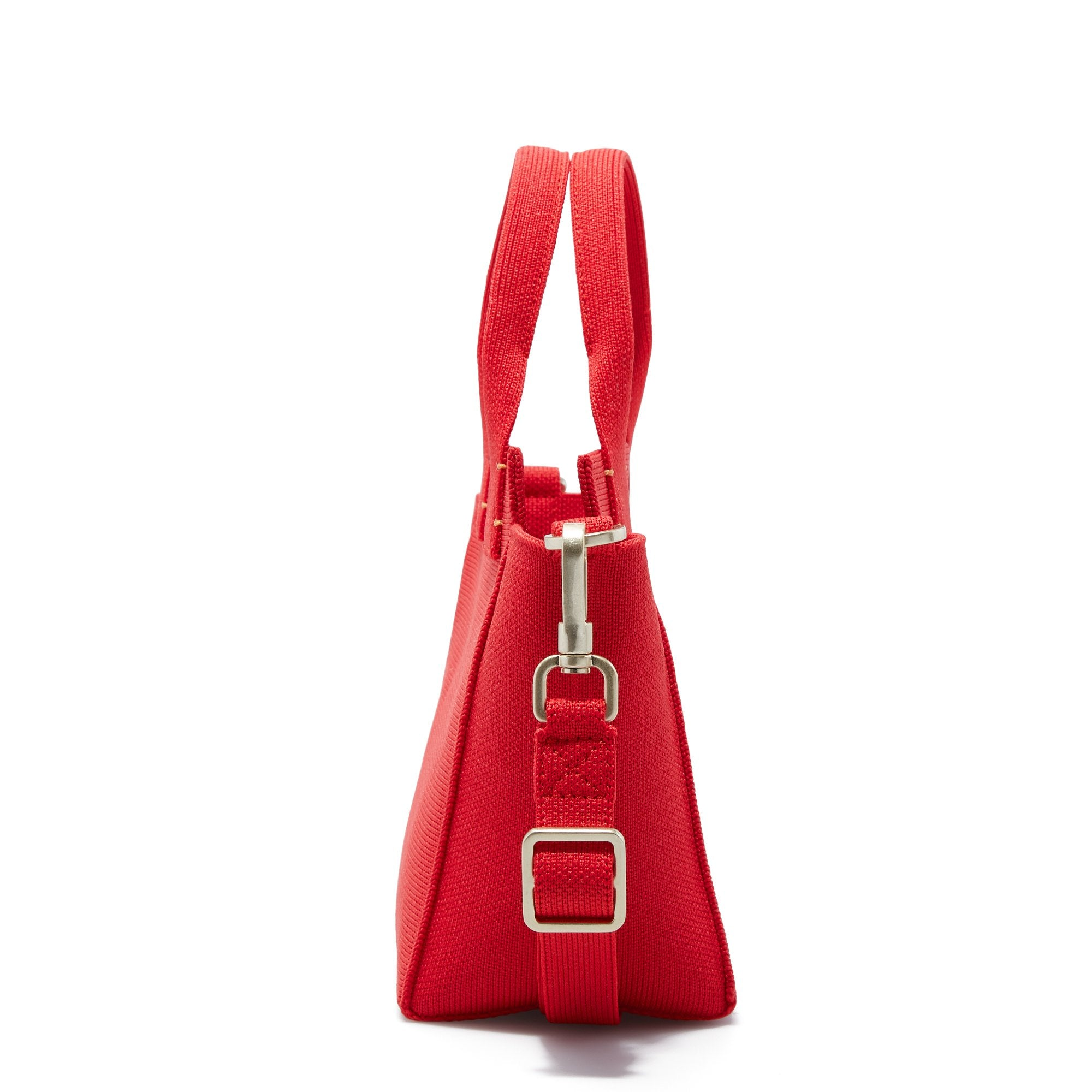 The Mini Handbag in Candy Apple shown from the side.