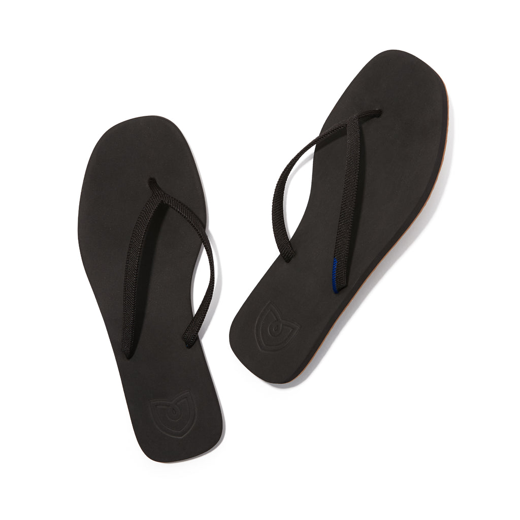 A pair of The Flip Flop sandals in Black shown from the top view.