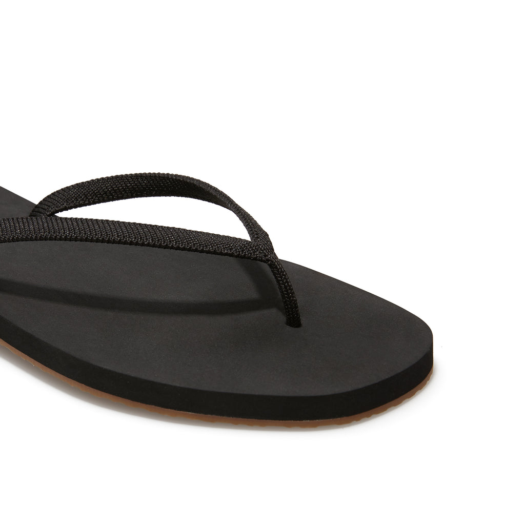 The Flip Flop sandal in Black shown from a front angle with strap detail.