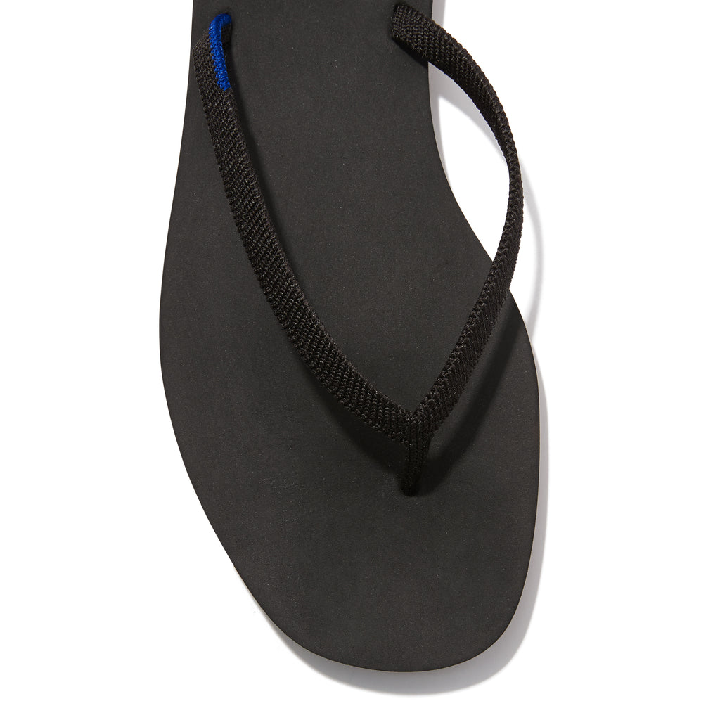 The Flip Flop sandal in Black shown from the top view with detailing of the front of the sandal.