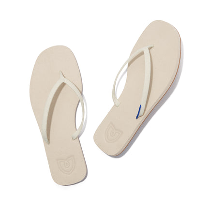 A pair of The Flip Flop sandals in Coconut shown from the top view.