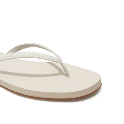 The Flip Flop sandal in Coconut shown from a front angle with strap detail.