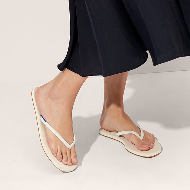 The Flip Flop sandal in Coconut shown on-model at an angle.