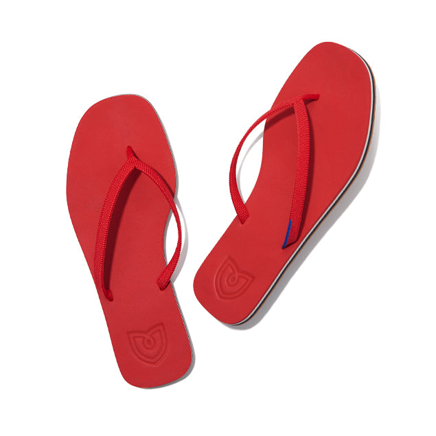 A pair of The Flip Flop sandals in Firecracker shown from the top view.