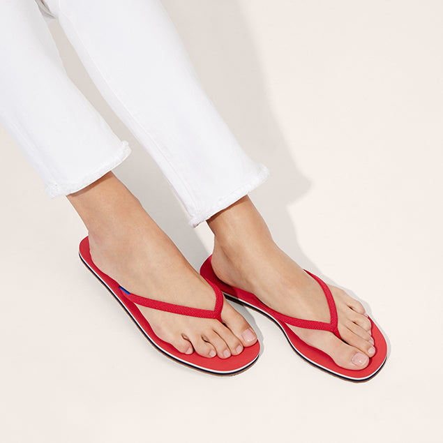 The Flip Flop sandal in Firecracker shown on-model at an angle.