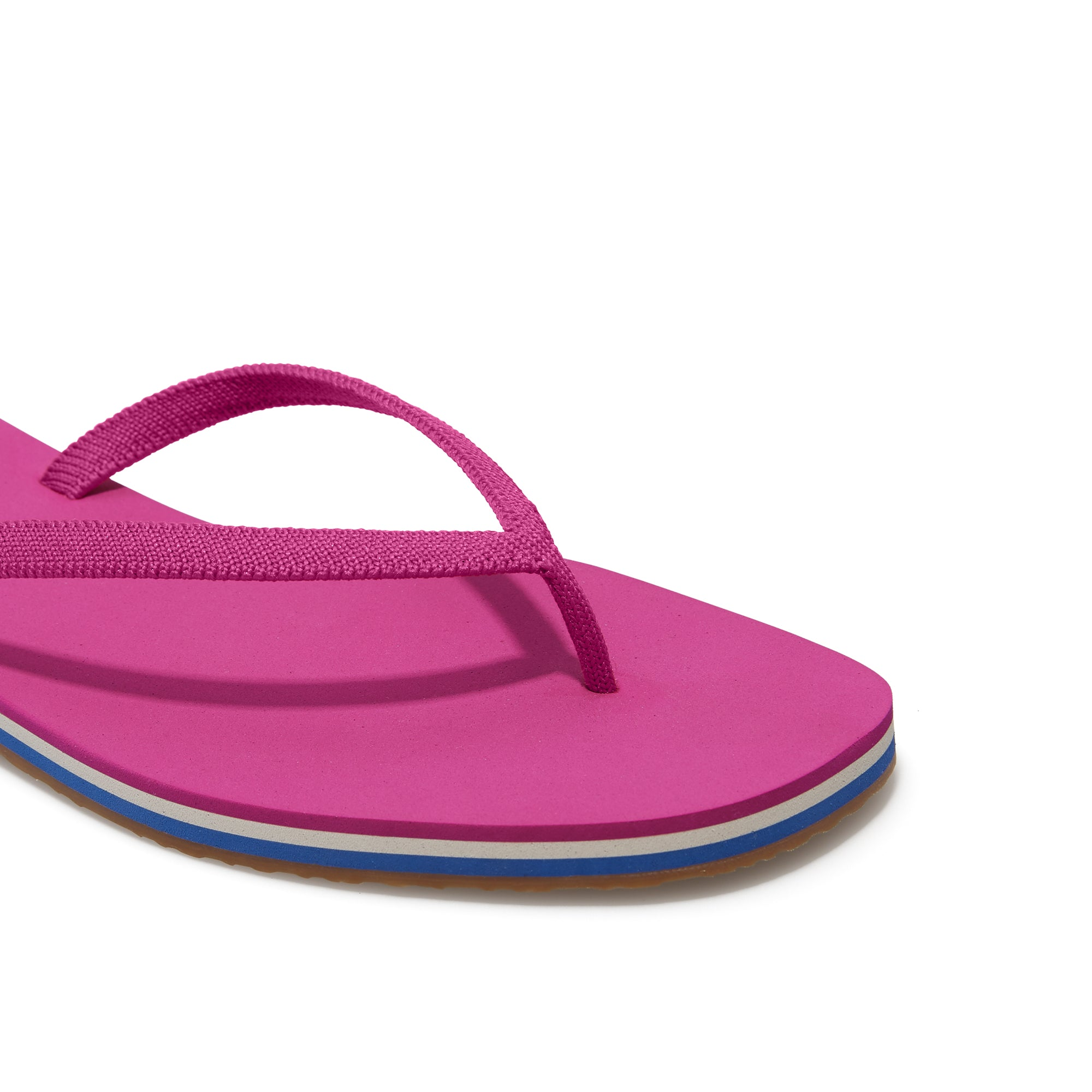 The Flip Flop sandal in Flamingo shown from the top view with detailing of the front of the sandal.