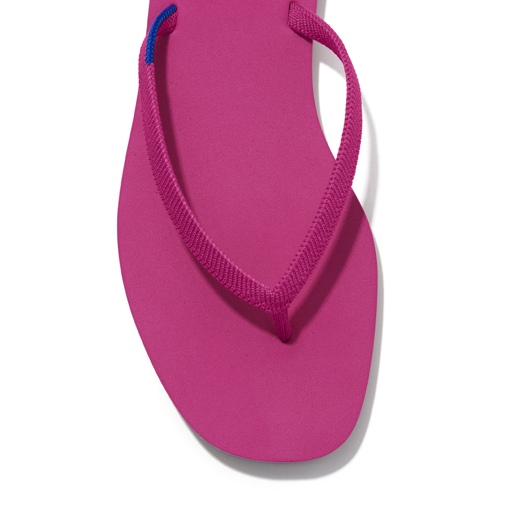 The Flip Flop sandal in Flamingo shown from a front angle with strap detail.