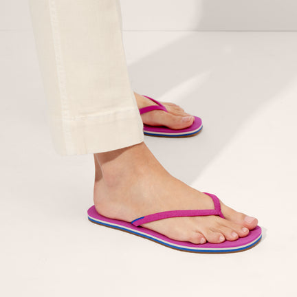 The Flip Flop sandal in Flamingo shown on-model at an angle.