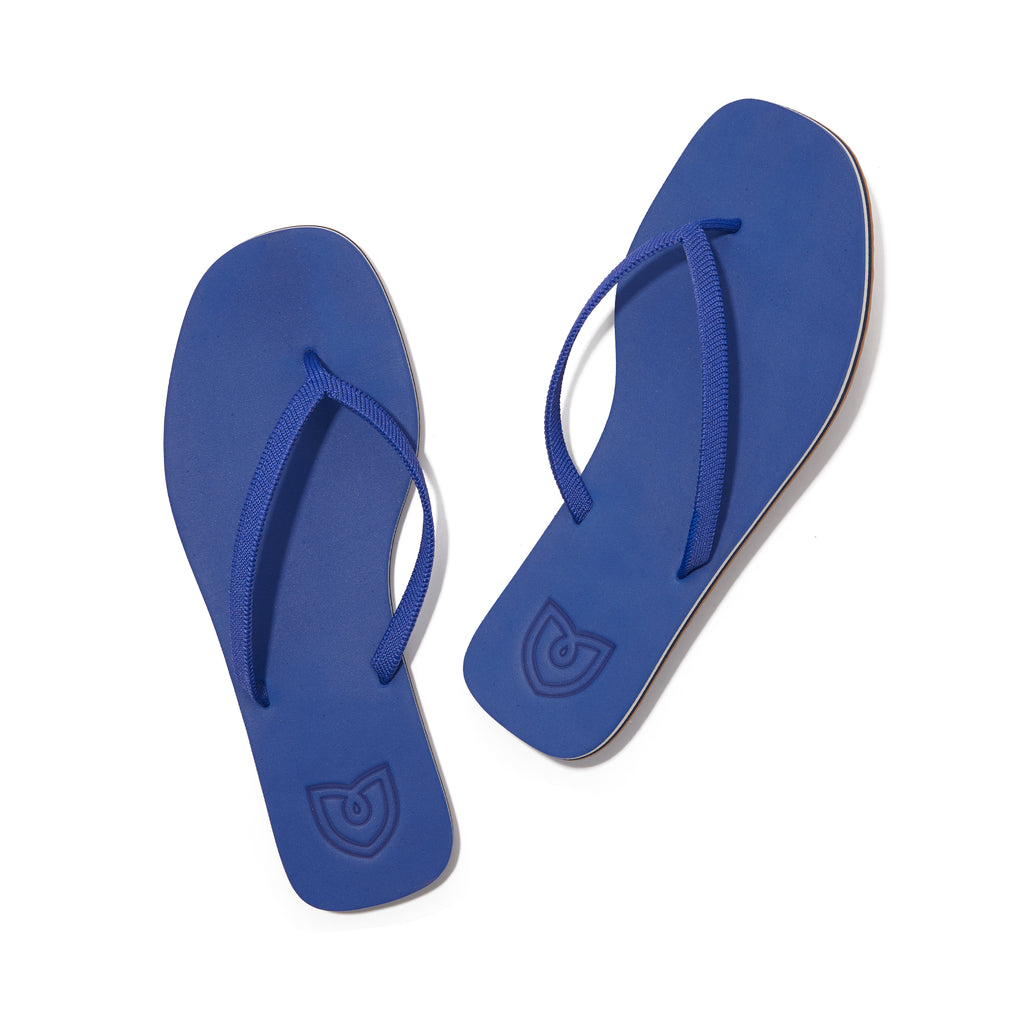 A pair of The Flip Flop sandals in Splash shown from the top view.