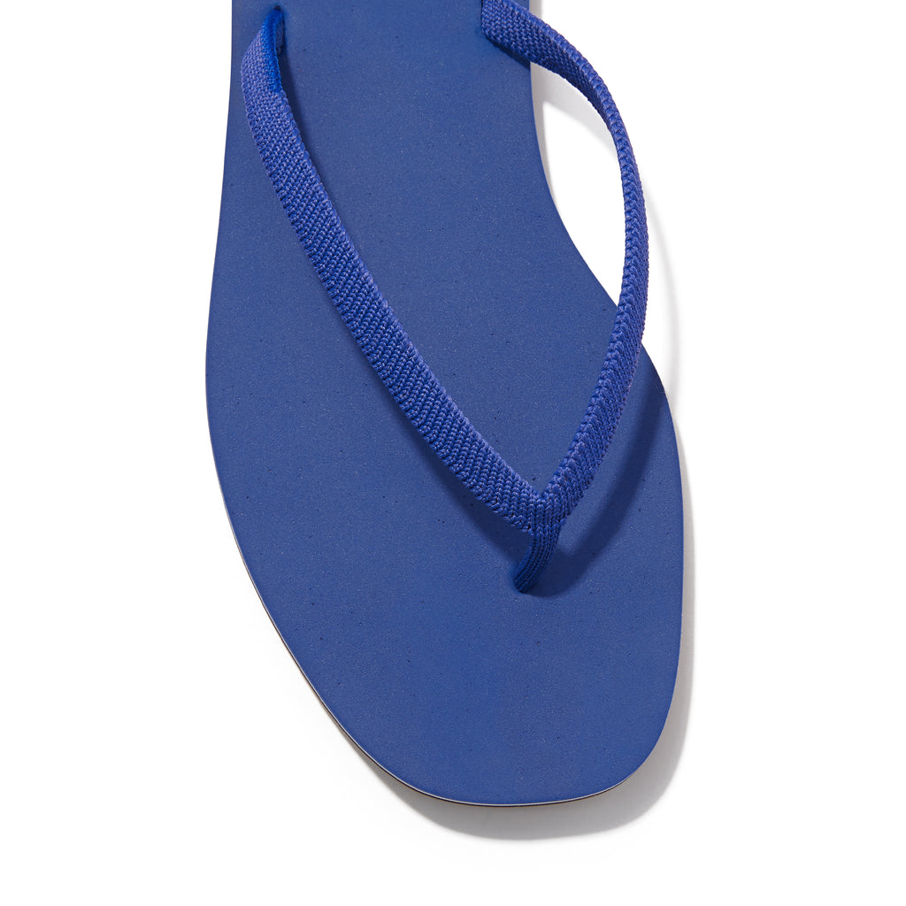 The Flip Flop sandal in Splash shown from a front angle with strap detail.